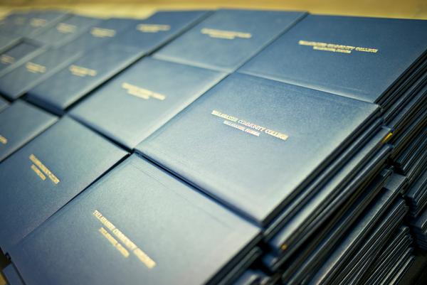 Stacks of TCC diplomas